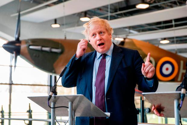British Foreign Secretary Boris Johnson speaks to media during a visit to a Battle of Britain bunker in Uxbridge, London, yesterday. Photo: Getty Images