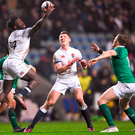 England's Gabriel Ibitoye catches a high ball ahead of Michael Silvester of Ireland during the U20 Six Nations Rugby Championship match. Photo: Harry Murphy/Sportsfile