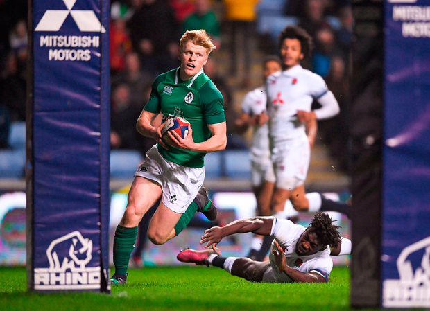 Ireland's Tommy O'Brien on his way to scoring his side's second try during the match. Photo: Harry Murphy/Sportsfile