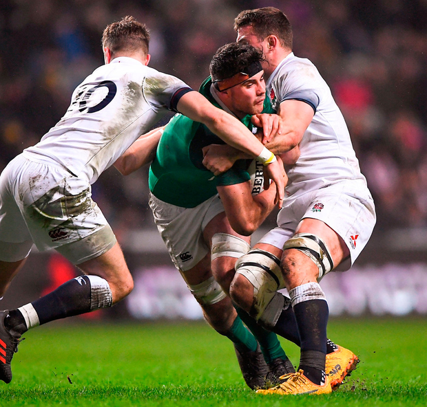 Ireland's Jack O'Sullivan is tackled by James Grayson, left, and Ben Earl of England during the U20 Six Nations match. Photo: Harry Murphy/Sportsfile