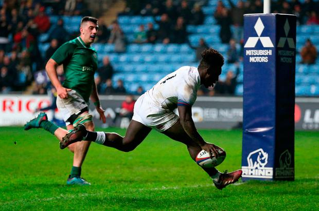 England Under 20's Gabriel Ibitoye scores a try. Photo: Nigel French/PA