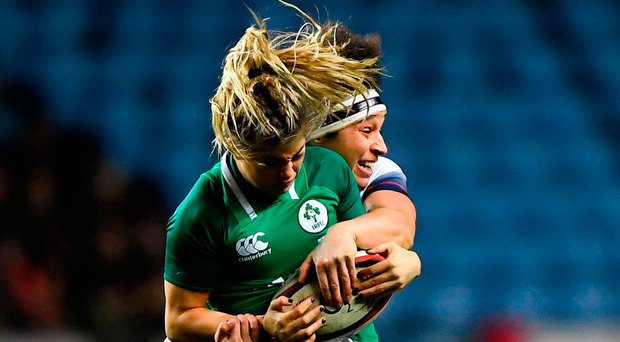 Ireland's Katie Fitzhenry is tackled by England's Lagi Tuima of England during the Women's Six Nations clash in Coventry. Photo: Harry Murphy/Sportsfile