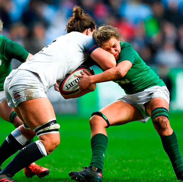 England's Abbie Scott is tackled by Ireland's Ashleigh Baxter during the match at the Ricoh Arena in Coventry. Photo: Harry Murphy/Sportsfile