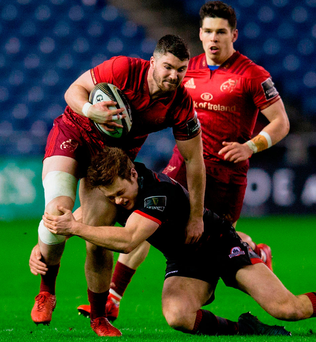 Munster's Sammy Arnold is tackled by Mark Bennett of Edinburgh during the match at Murrayfield. Photo: Kenny Smith/Sportsfile