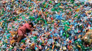 A worker takes a break at a Chinese recycling centre in Jiaxing