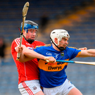 Tipperary's Brendan Maher attempts to get away from Cork's Conor Lehane during their league game at Semple Stadium. Photo: Sportsfile