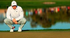 Rory McIlroy prepares to putt during his impressive second round at Bay Hill. Photo: Getty