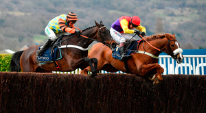 Native River and Richard Johnson sail over the final fence ahead of Might Bite (Nico de Boinville) on their way to landing the Gold Cup. Photo: Sportsfile