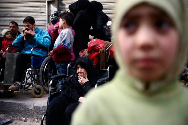 An elderly woman sits in a wheelchair in the besieged town of Douma, Eastern Ghouta, in Damascus, Syria March 15, 2018. REUTERS/Bassam Khabieh TPX IMAGES OF THE DAY