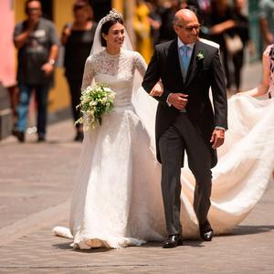 Peruvian Alessandra de Osma (L), arrives next to her father Felipe de Osma, to her wedding with Prince Christian of Hanover at the San Pedro church in Lima on March 16, 2018. / AFP PHOTO / ERNESTO BENAVIDESERNESTO BENAVIDES/AFP/Getty Images