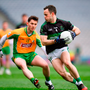 Alan Cronin of Nemo Rangers in action against Ian Burke of Corofin