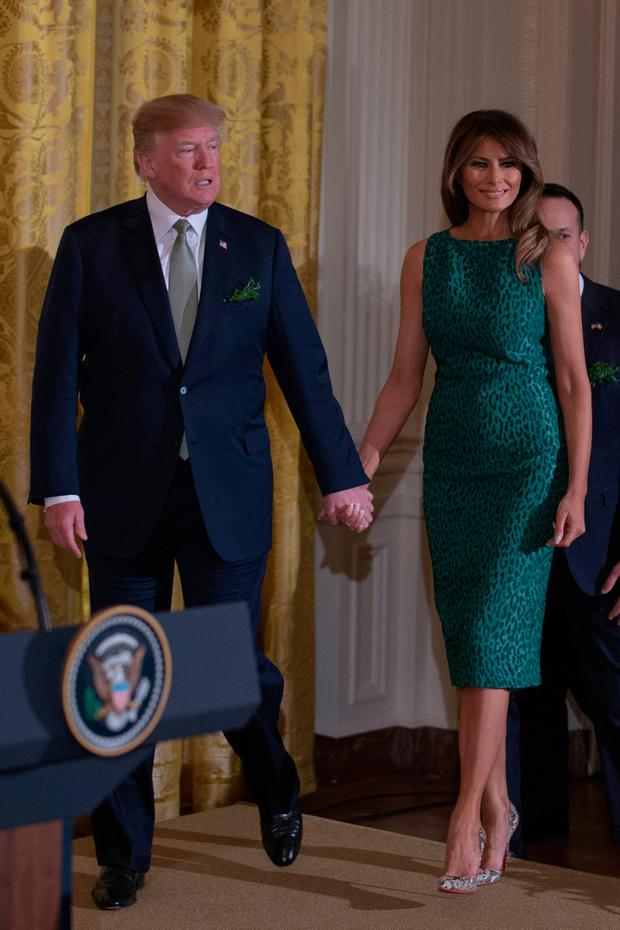 United States President Donald J. Trump and first lady Melania Trump enter the East Room of the White House prior to the Shamrock Bowl Presentation at the White House on March 15, 2018 in Washington, D.C. (Photo by Alex Edelman-Pool/Getty Images)