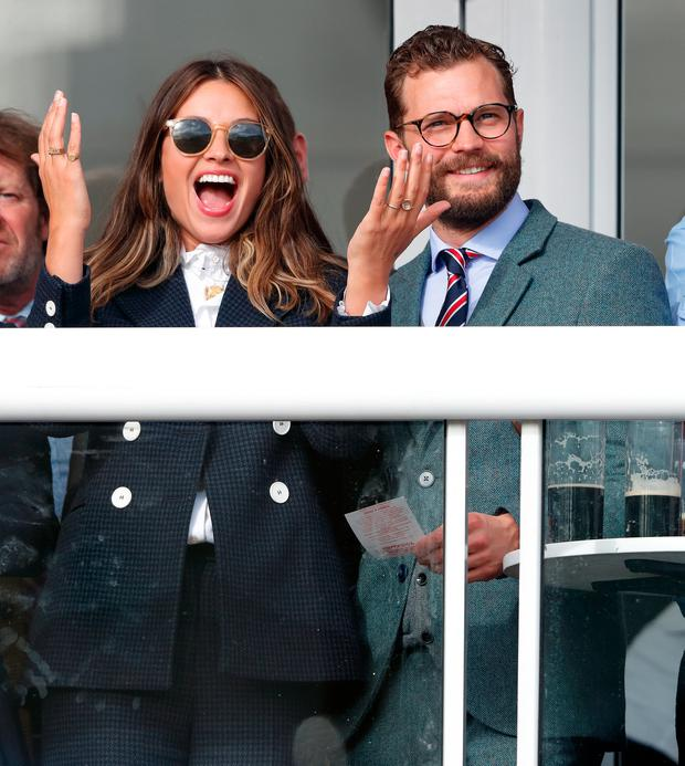 Amelia Warner and Jamie Dornan attend day 4 'Gold Cup Day' of the Cheltenham Festival at Cheltenham Racecourse on March 16, 2018 in Cheltenham, England. (Photo by Max Mumby/Indigo/Getty Images)