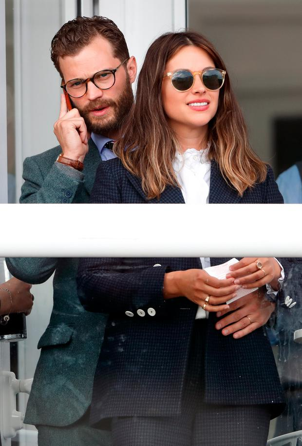 Jamie Dornan and Amelia Warner attend day 4 'Gold Cup Day' of the Cheltenham Festival at Cheltenham Racecourse on March 16, 2018 in Cheltenham, England. (Photo by Max Mumby/Indigo/Getty Images)