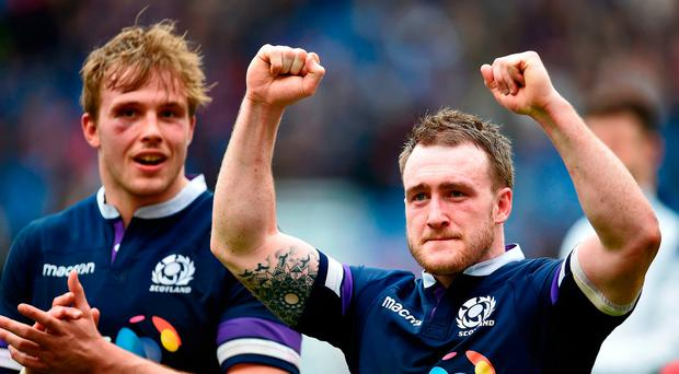 Scotland's Stuart Hogg (R) celebrates at the end of the Six Nations international rugby union match between Italy and Scotland at the Olympic Stadium in Rome, on March 17, 2018. Scotland beat Italy 29-27. / AFP PHOTO / FILIPPO MONTEFORTEFILIPPO MONTEFORTE/AFP/Getty Images