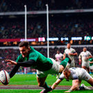 Jacob Stockdale of Ireland dives over to score his side's third try