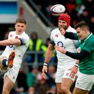 England's Owen Farrell accidently kicks the ball at the head of James Haskell
