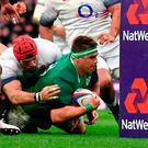 Ireland's number 8 Cj Stander (R) grounds the ball at the base of the post to score their second try during the Six Nations international rugby union match between England and Ireland at the Twickenham, west London, on March 17, 2018. / AFP PHOTO / Ben STANSALLBEN STANSALL/AFP/Getty Images