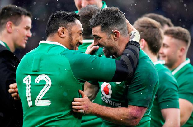 Ireland's Bundee Aki celebrates with Rob Kearney at the end of the match
