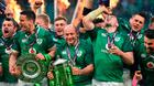 Ireland's hooker Rory Best (C) holds the Six Nations trophy