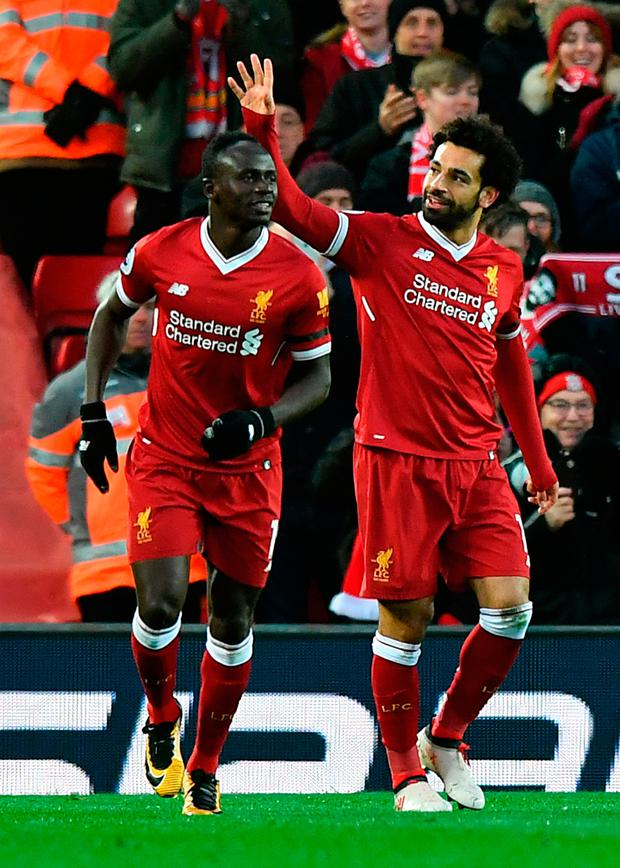 Liverpool's Mohamed Salah celebrates scoring his team's second goal