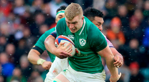 Ireland's Dan Leavy looks to break free of the English defence in Twickenham yesterday. Photo: Gerry Mooney