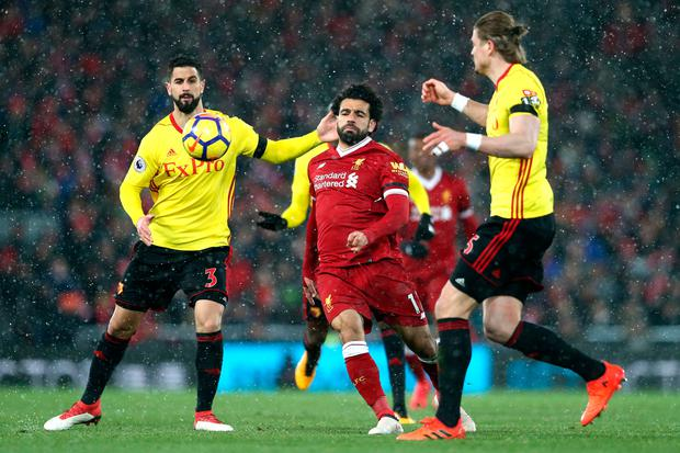 Mohamed Salah of Liverpool is challenged by Miguel Britos of Watford. Photo: Getty Images