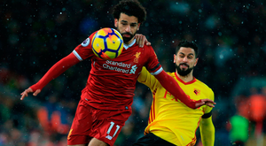 Liverpool matchwinner Mohamed Salah is tackled by Watford's Etienne Capoue at Anfield. Photo: Getty Images