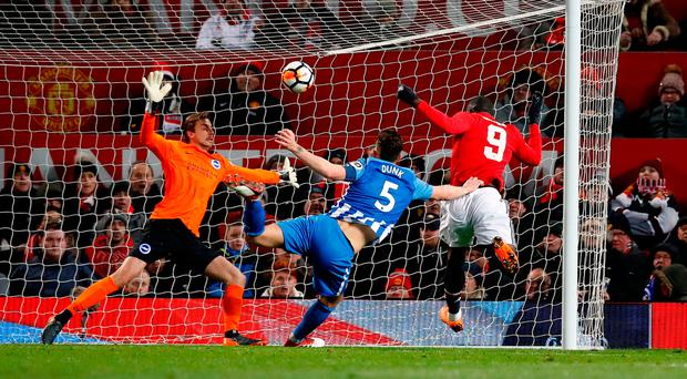 Manchester United's Romelu Lukaku scores his side's first goal against Brighton last night. Photo: PA Wire