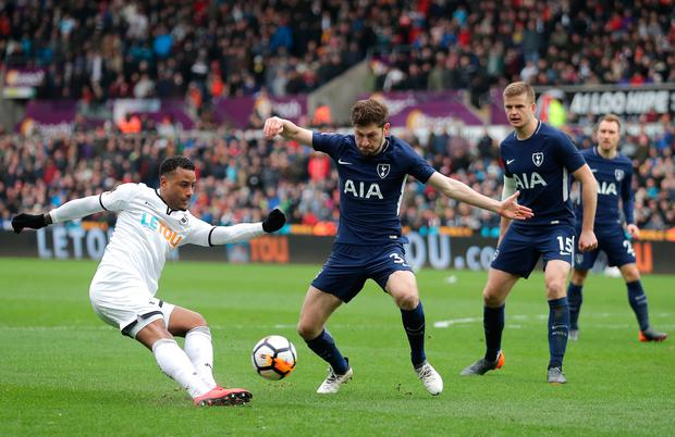 Luciano Narsingh of Swansea City crosses the ball under pressure from Ben Davies of Tottenham Hotspur. Photo: Getty Images