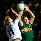 Kerry's Peter Crowley rises with Kildare's Keith Cribbin. Photo: Sportsfile