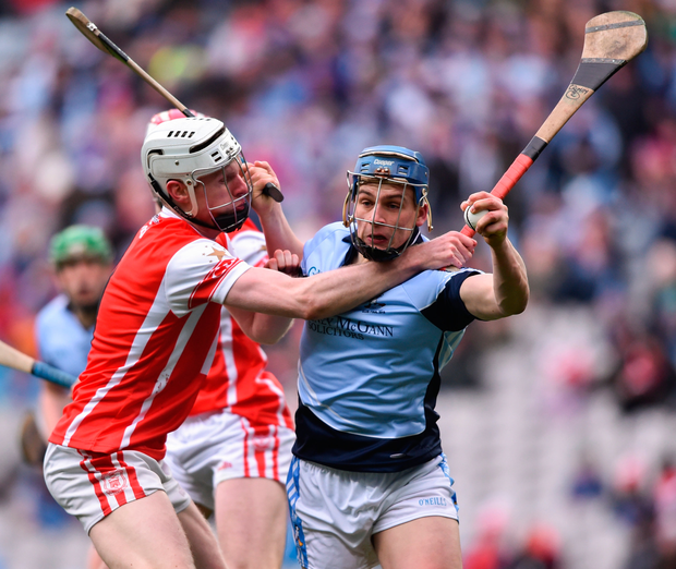 Cuala's Colm Cronin challenges Na Piarsaigh's Mike Casey. Photo: Sportsfile