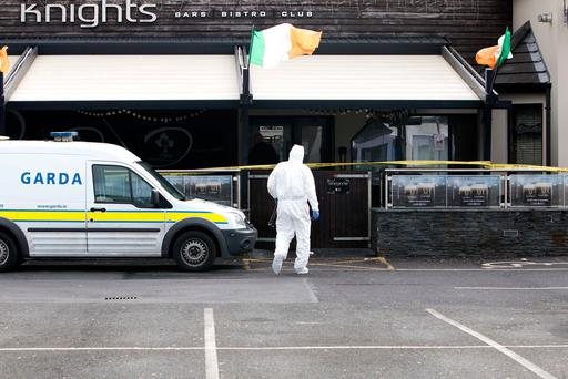 A forensic Garda at a pub in Shannon town centre where a man has died and another is being treated in hospital following a stabbing incident in Co Clare. Photograph Press 22