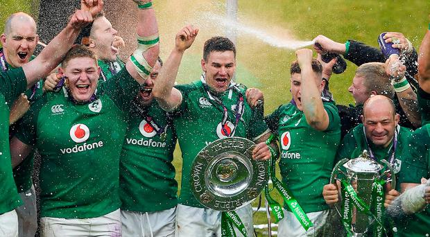 Ireland players, from left, Devin Toner, Tadhg Furlong, Jacob Stockdale, Cian Healy, Jonathan Sexton, Jordan Larmour and Rory Best celebrate with the Six Nations and Triple Crown trophies after the NatWest Six Nations Rugby Championship match between England and Ireland at Twickenham Stadium in London, England. Photo by Harry Murphy/Sportsfile