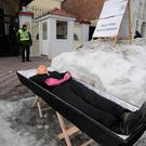 An effigy, depicting Russian President Vladimir Putin, is seen inside a coffin in a front of the Russian consulate during a performance, part of a rally held by Ukrainian nationalists in Kharkiv, Ukraine March 18, 2018. REUTERS/Stanislav Belousov