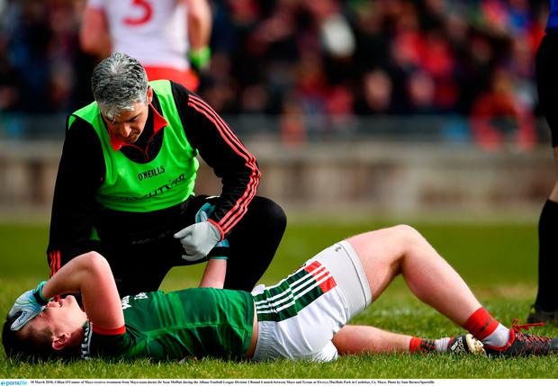 18 March 2018; Cillian O'Connor of Mayo receives treatment from Mayo team doctor Dr Sean Moffatt during the Allianz Football League Division 1 Round 6 match between Mayo and Tyrone at Elverys MacHale Park in Castlebar, Co. Mayo. Photo by Sam Barnes/Sportsfile