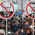 Supporters of Ukrainian opposition figure and Georgian former President Mikheil Saakashvil hold placards depicting Ukrainian President Petro Poroshenko and Russian President Vladimir Putin during a rally demanding a resignation of Poroshenko, at the Independence Square in Kiev, Ukraine March 18, 2018. REUTERS/Serhii Nuzhnenko