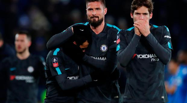 Chelsea's Olivier Giroud celebrates after the match with Pedro and Marcos Alonso