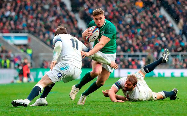 England's Elliot Daly (left) and Chris Robshaw (right) attempt to tackle Ireland's Jordan Larmour. Photo: PA