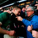 Billy Keane shares a word with his godson Jonathan Sexton as he celebrates Ireland's Grand Slam win at Twickenham. Photo: PA