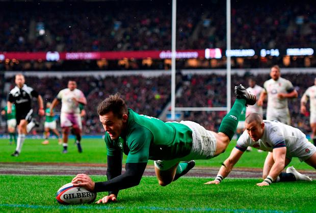 Jacob Stockdale dives over to score Ireland's third try. Photo: Ramsey Cardy/Sportsfile