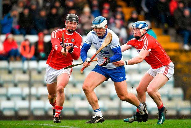 Tom Devine of Waterford is crowded out by Cork pair Colm Spillane (left) and Sean O'Donoghue. Photo: Eóin Noonan/Sportsfile