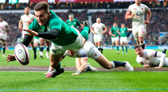 Jacob Stockdale scoring a try against England for the Grand Slam. Photo: PA