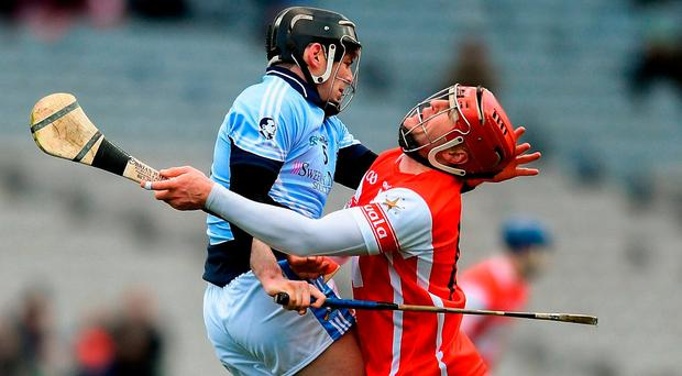 Cuala forward David Treacy (right) clashes with Alan Dempsey of Na Piarsaigh in Croke Park on Saturday. Photo: Eóin Noonan/Sportsfile