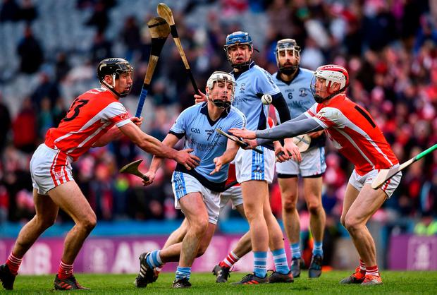 Na Piarsaigh's Kieran Kennedy in action against Mark Schutte, left, and Con O'Callaghan. Photo: David Fitzgerald/Sportsfile