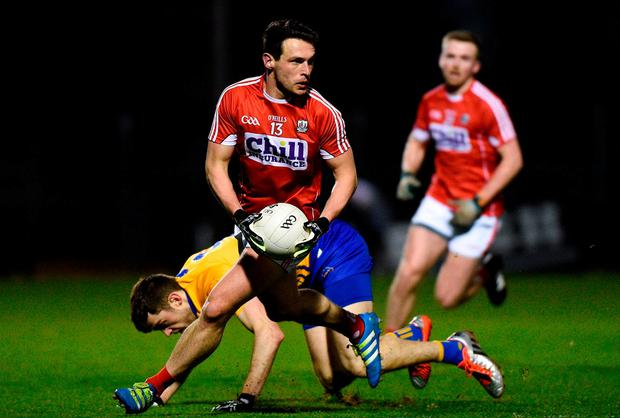 John O'Rourke fends off Clare's Cillian Brennan. Photo: Matt Browne/Sportsfile