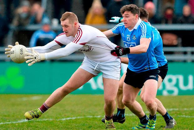 Galway keeper Ronan O'Beolain gets to the ball ahead of Dublin's Paddy Andrews. Photo: Ray Ryan/Sportsfile