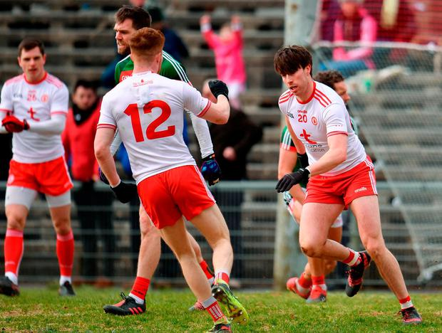Conal McCann, right, celebrates after scoring Tyrone's second goal with teammate Cathal McShane. Photo: Sam Barnes/Sportsfile