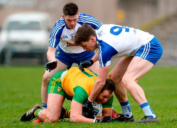 Donegal's Michael Murphy under pressure from David Garland, left, and Niall Kearns. Photo: Oliver McVeigh/Sportsfile