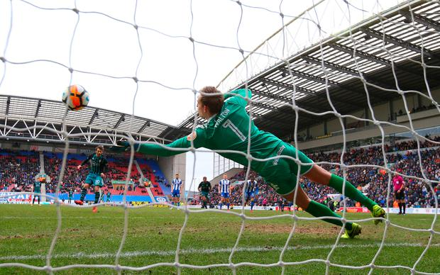 Wigan Athletic's Christian Walton saves a penalty from Southampton's Manolo Gabbiadini. Photo: Getty Images